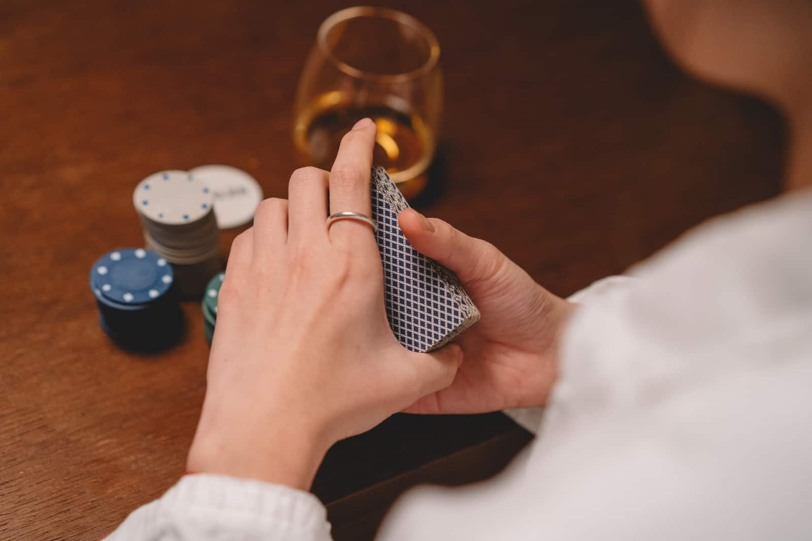 woman shuffles a deck of cards