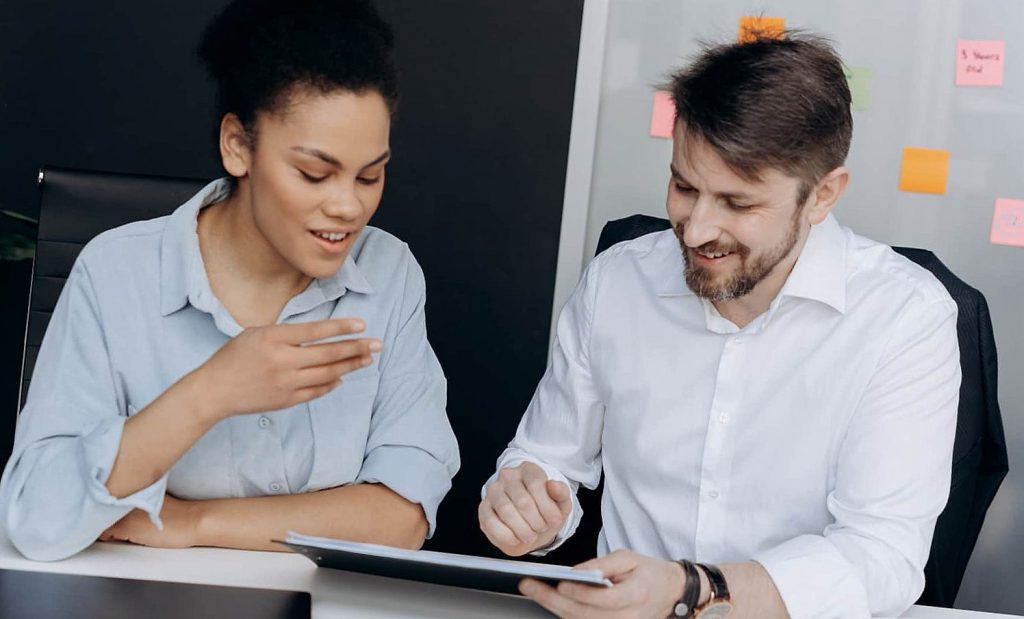 Woman and man are playing online on tablet